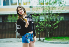 Young woman eating ice-cream sunny day outdoors Royalty Free Stock Photos