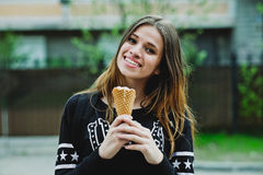Young woman eating ice-cream sunny day outdoors Royalty Free Stock Photography