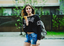 Young woman eating ice-cream sunny day outdoors Royalty Free Stock Image