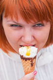 Young woman eating icecream cone Stock Image
