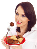 Young Woman Eating Indian Snack Food Royalty Free Stock Images