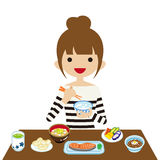 Young woman eating Japanese breakfast Royalty Free Stock Image