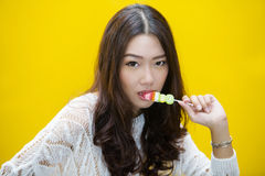 Young woman eating jelly candies royalty free stock photo