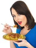 Young Woman Eating Lamb Rogan Josh Indian Curry Royalty Free Stock Photos