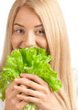 Young woman eating lettuce Royalty Free Stock Image