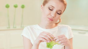 Young woman eating lettuce. Organic food stock footage