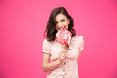 Young woman eating lollipop Royalty Free Stock Photo