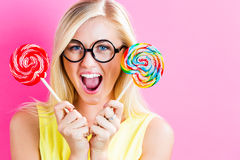 Young woman eating a lollipop Royalty Free Stock Photography