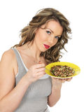 Young Woman Eating a Mixed Bean Salad and Brown Rice Salad Stock Image