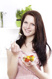 Young woman eating mixed salad Stock Photography