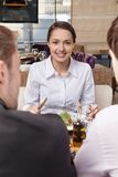 Young woman eating mixed vegetable salad in cafe. Royalty Free Stock Image