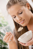 Young woman eating muesli Royalty Free Stock Image