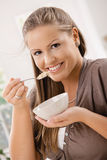 Young woman eating muesli Stock Photo