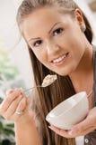 Young woman eating muesli Stock Photo