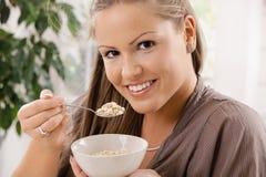 Young woman eating muesli Stock Image