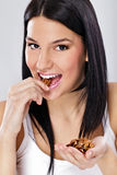 Young woman eating nut stock photo