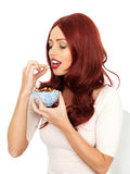 Young Woman Eating Nuts Stock Photos