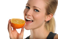 Young Woman Eating Orange Stock Photography