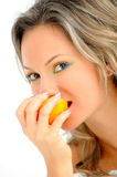 Young woman eating orange Stock Image