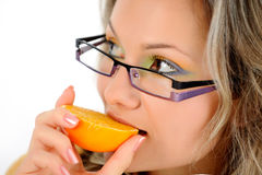 Young woman eating orange Royalty Free Stock Photos
