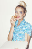 Young woman eating  piece of pizza Royalty Free Stock Images