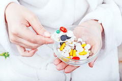 Young woman eating pills Royalty Free Stock Photography