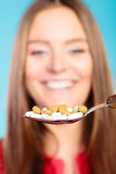 Young woman eating pills on a spoon Royalty Free Stock Photos