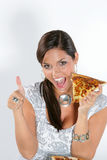 Young woman eating pizza Stock Photo