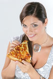 Young woman eating pizza Royalty Free Stock Images