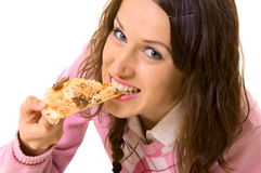 Young woman eating pizza Stock Photography