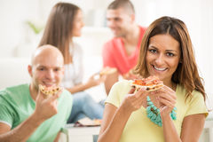Young woman eating pizza Royalty Free Stock Photography