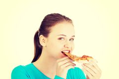 Young woman eating pizza. Stock Photography