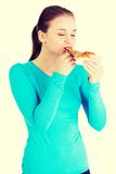 Young woman eating pizza. Royalty Free Stock Photos
