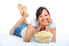 Young woman eating popcorn Stock Photography