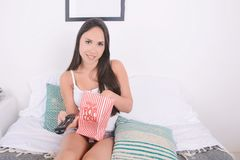 Woman eating popcorn and watching movies. Royalty Free Stock Photo