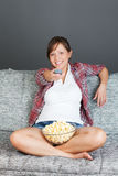 Young woman eating popcorn Royalty Free Stock Photography