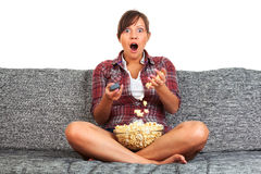 Young woman eating popcorn Stock Photos