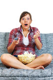 Young woman eating popcorn Stock Image