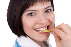 Young woman eating potato chips. Royalty Free Stock Photography