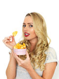 Young Woman Eating Potato Crisps Stock Photos