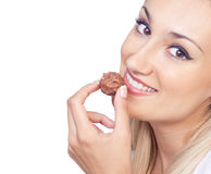 Young woman eating praline Stock Photography
