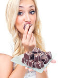 Young woman eating pralines Royalty Free Stock Image