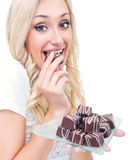 Young woman eating pralines Stock Photography