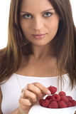 Young woman eating raspberry Royalty Free Stock Image