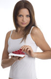 Young woman eating raspberry.  stock photos