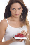 Young woman eating raspberry.  royalty free stock image
