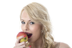 Young Woman Eating a Red Apple Stock Photos