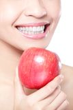 Young woman eating red apple with health teeth Stock Image