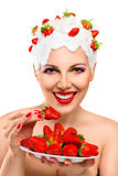 Young woman eating red ripe Royalty Free Stock Images