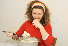 Young woman eating salad. With greediness Stock Photography